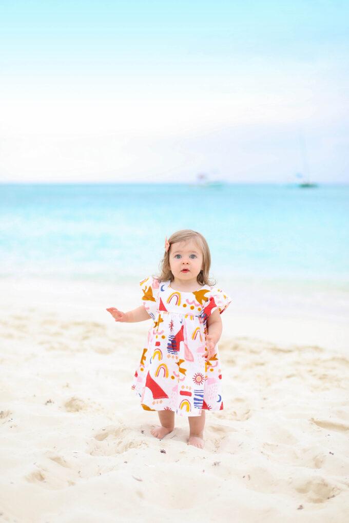 baby walking on beach