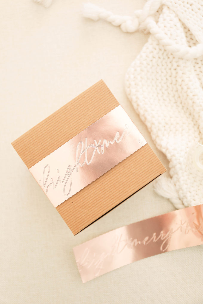 attach gift sleeve with tape to brown box