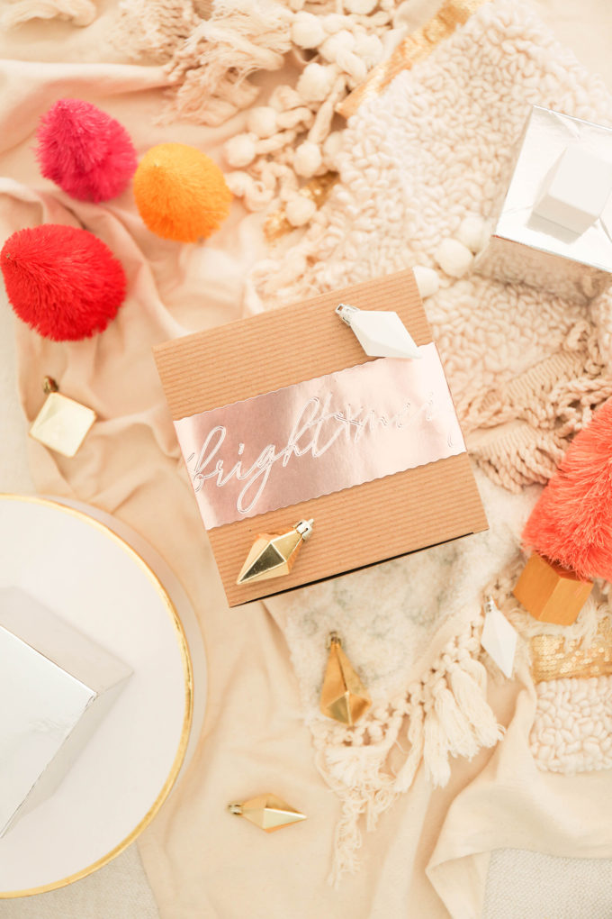 personalized holiday gift styled with ornaments and texture