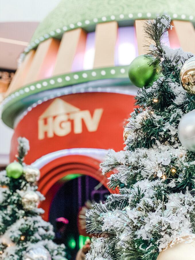 HGTV santa hq sign behind a christmas tree closeup