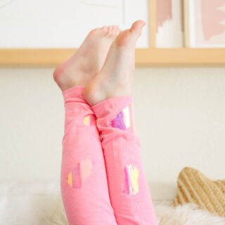 little girl's legs in the air with pink leggings