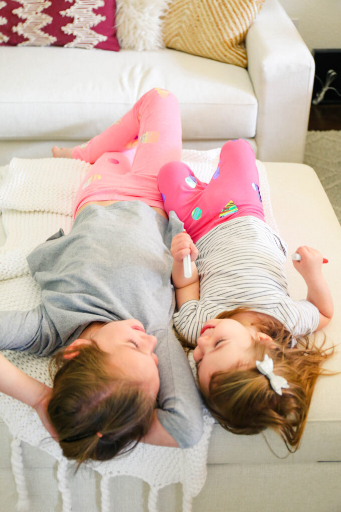 little girls laying on floor laughing