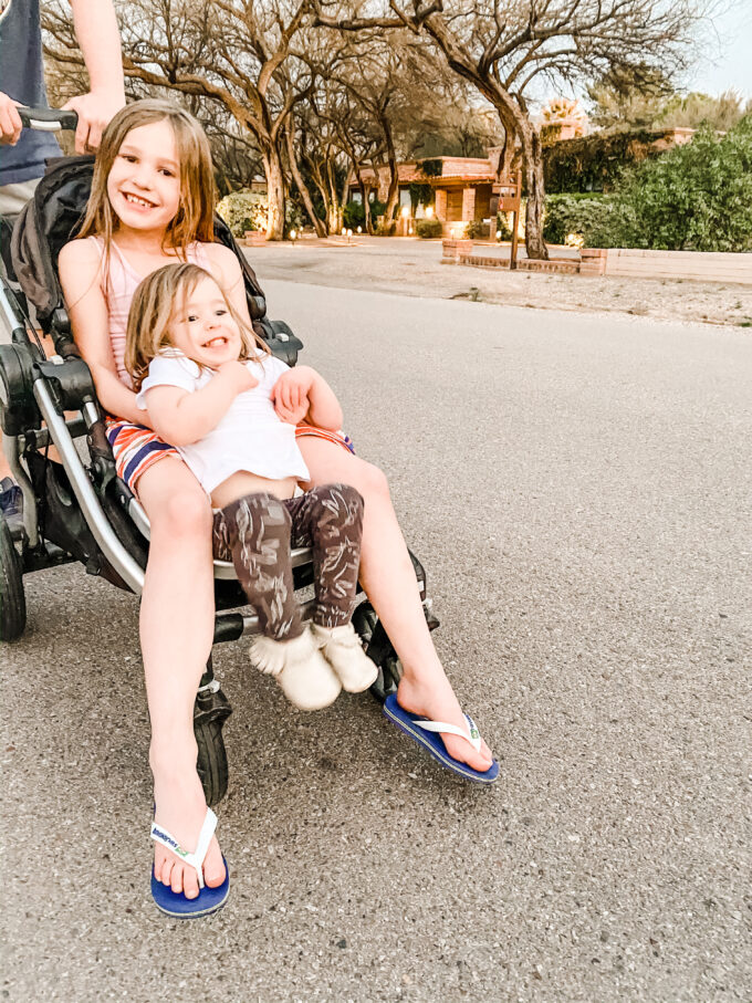 sisters sitting together in stroller