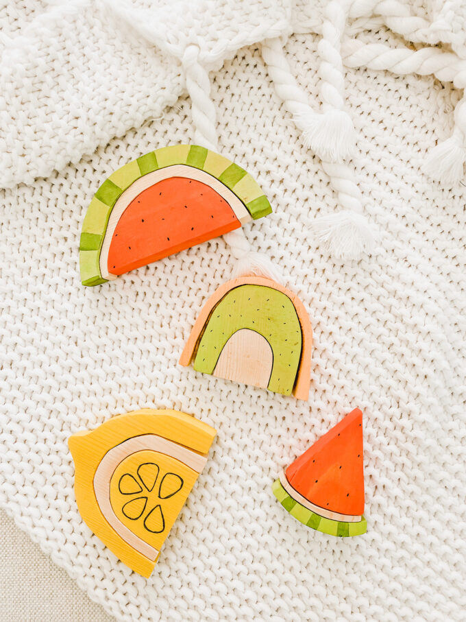 DIY Wooden Fruit Stacking Toys spread out on blanket