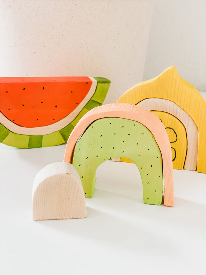 closeup of kiwi melon wooden stacking toy
