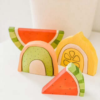 closeup of wooden fruit stacking toys