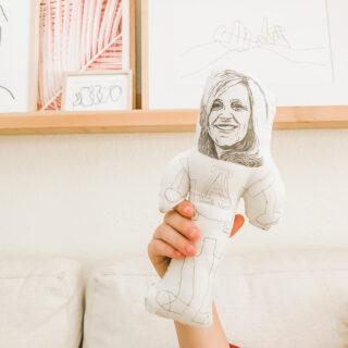 Hand holding homemade doll