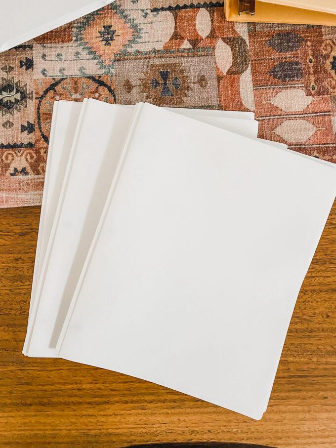 white folders on table