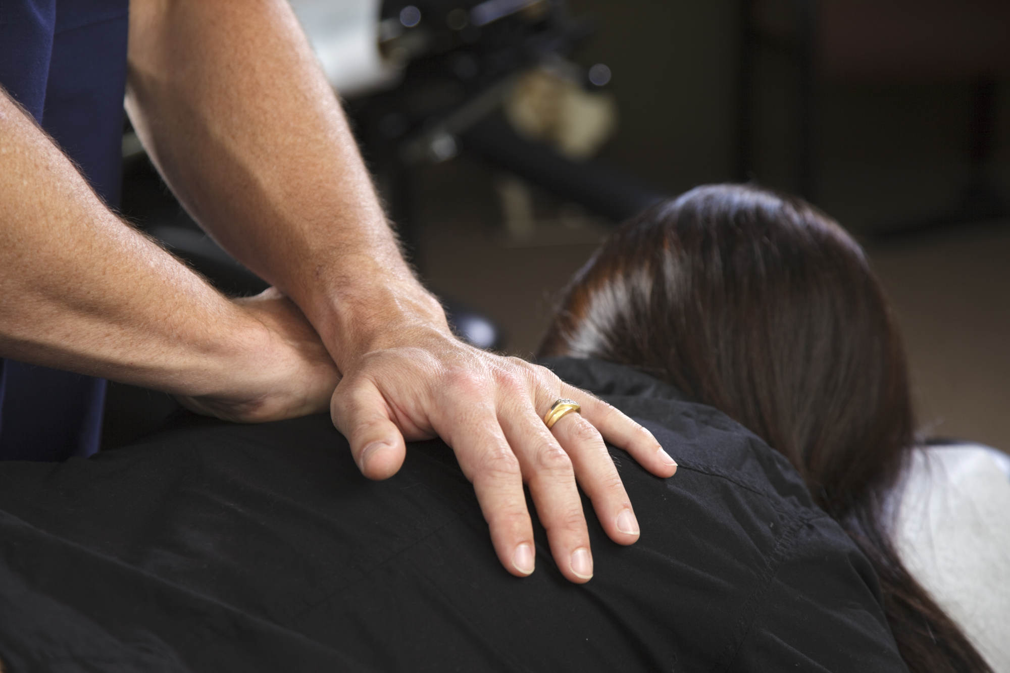 A patient receiving a treatment in a chiropractor office.