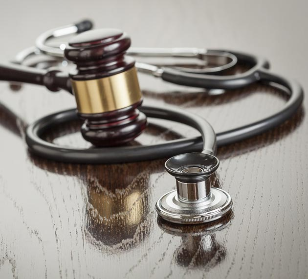 Stethoscope and Gavel on Wood Table