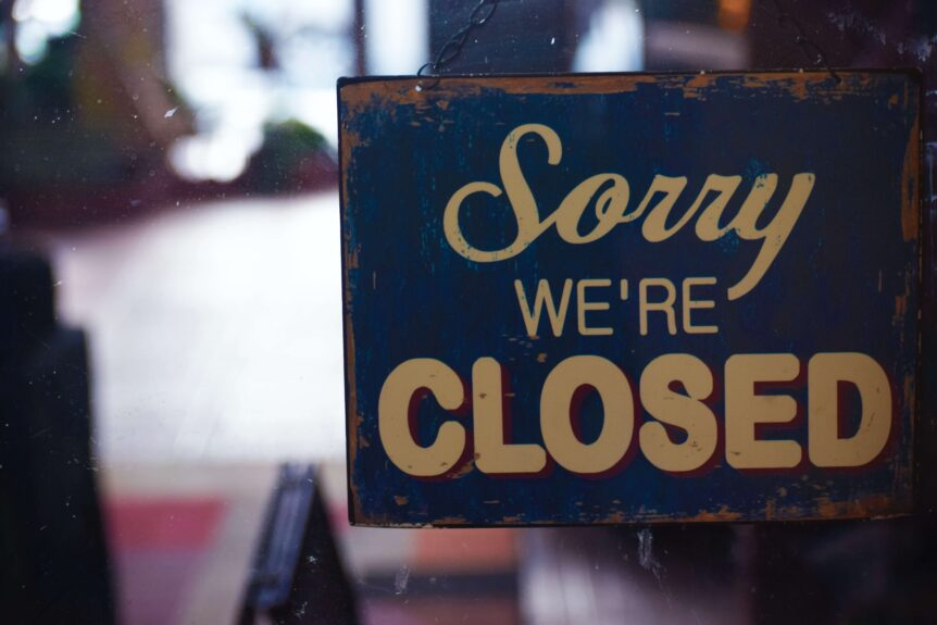 business interruption losses cause store to place Closed sign in window