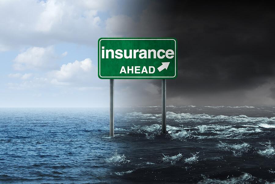 Sign in flood waters Hurricane Insurance Claim