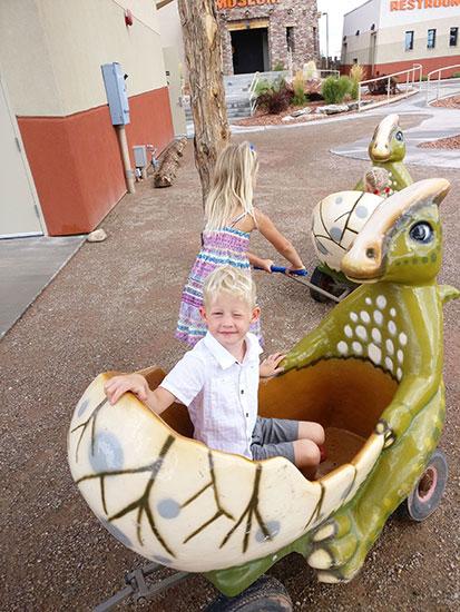 Dinosaur Stroller with children in it