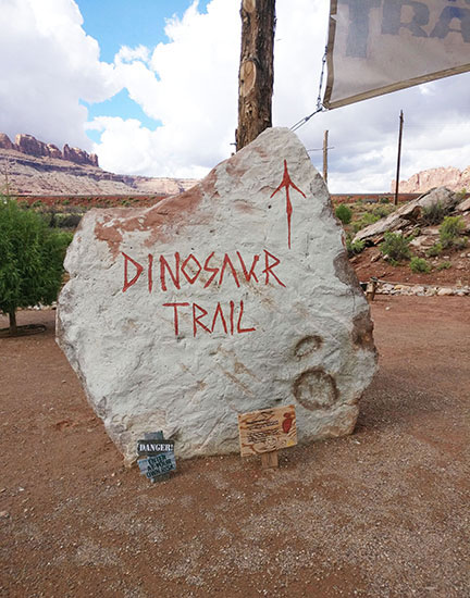 A Sign showing the way to the path for the Dinosaur Trail