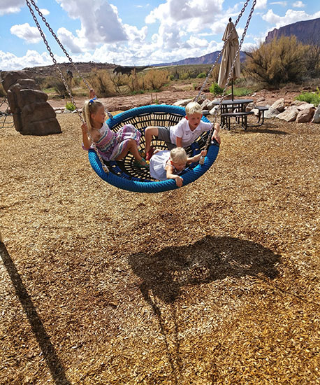 Oversized Swing on the playground at Moab Giants