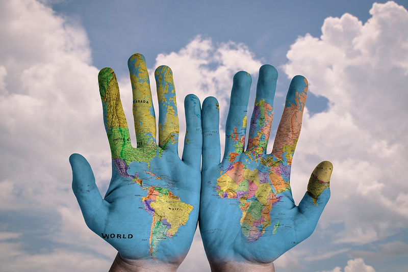 painted hands world map
