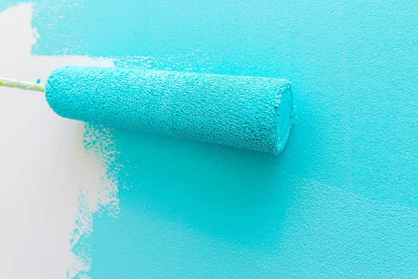 painting a fresh coat of blue paint