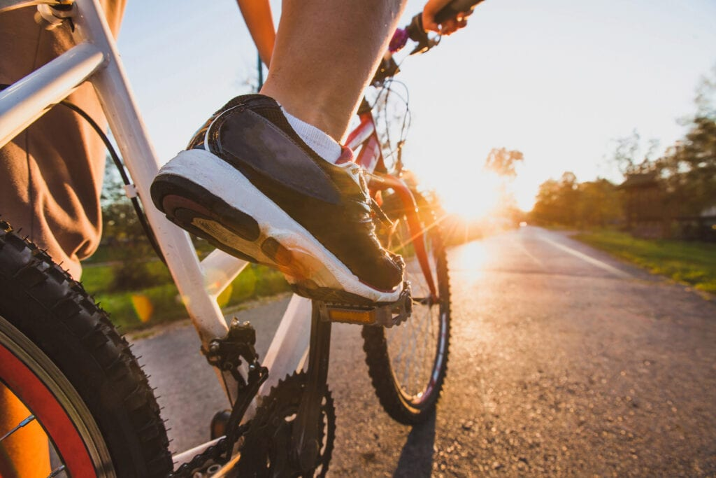 up close foot on bike pedal stay active spring