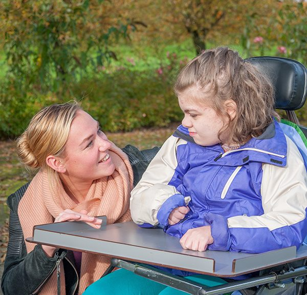 caregiver with handicapped girl