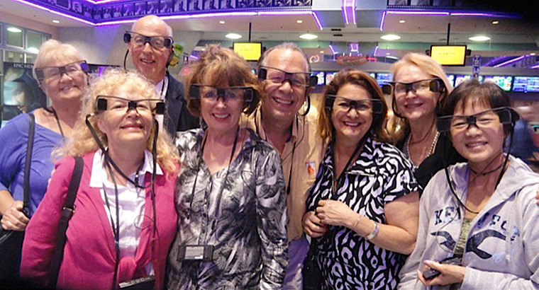 A Group of Movie Theater Patrons Wearing Accessible Caption Glasses