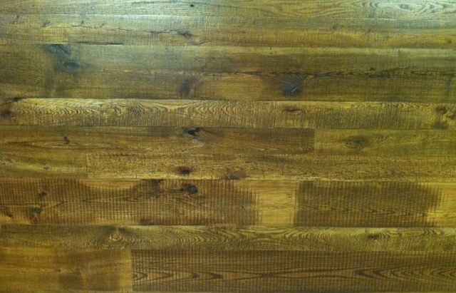 close up of antique ash reclaimed wood wall paneling