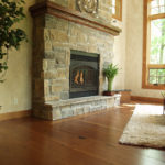 reclaimed wood fireplace mantel by Manomin Resawn Timbers