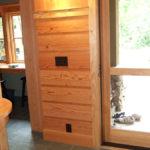 Wall with douglas fir wood paneling