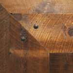 Close up of texture on weathered antique reclaimed wood flooring