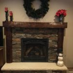 dark reclaimed wood mantel by Manomin Resawn Timbers