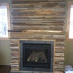 reclaimed paneling above fireplace
