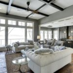 Clean living room with weathered antique wood flooring