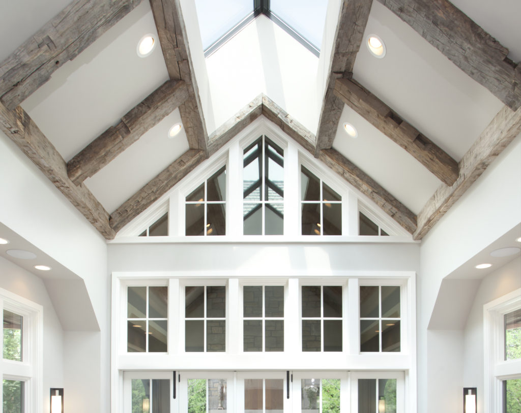 reclaimed timbers vaulted ceiling living room