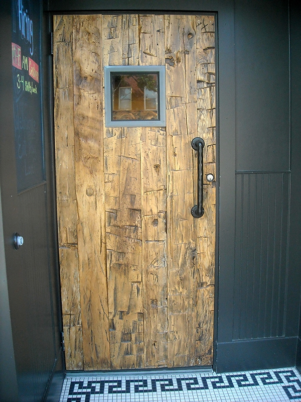 Yellow hand hewn barn door