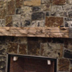 reclaimed wood mantel with iron strap
