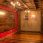 wine room with golden and brown antique timbers