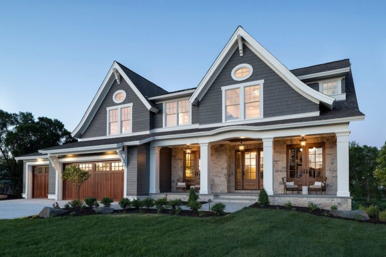 beautiful blue and white home with channel lap rustic siding