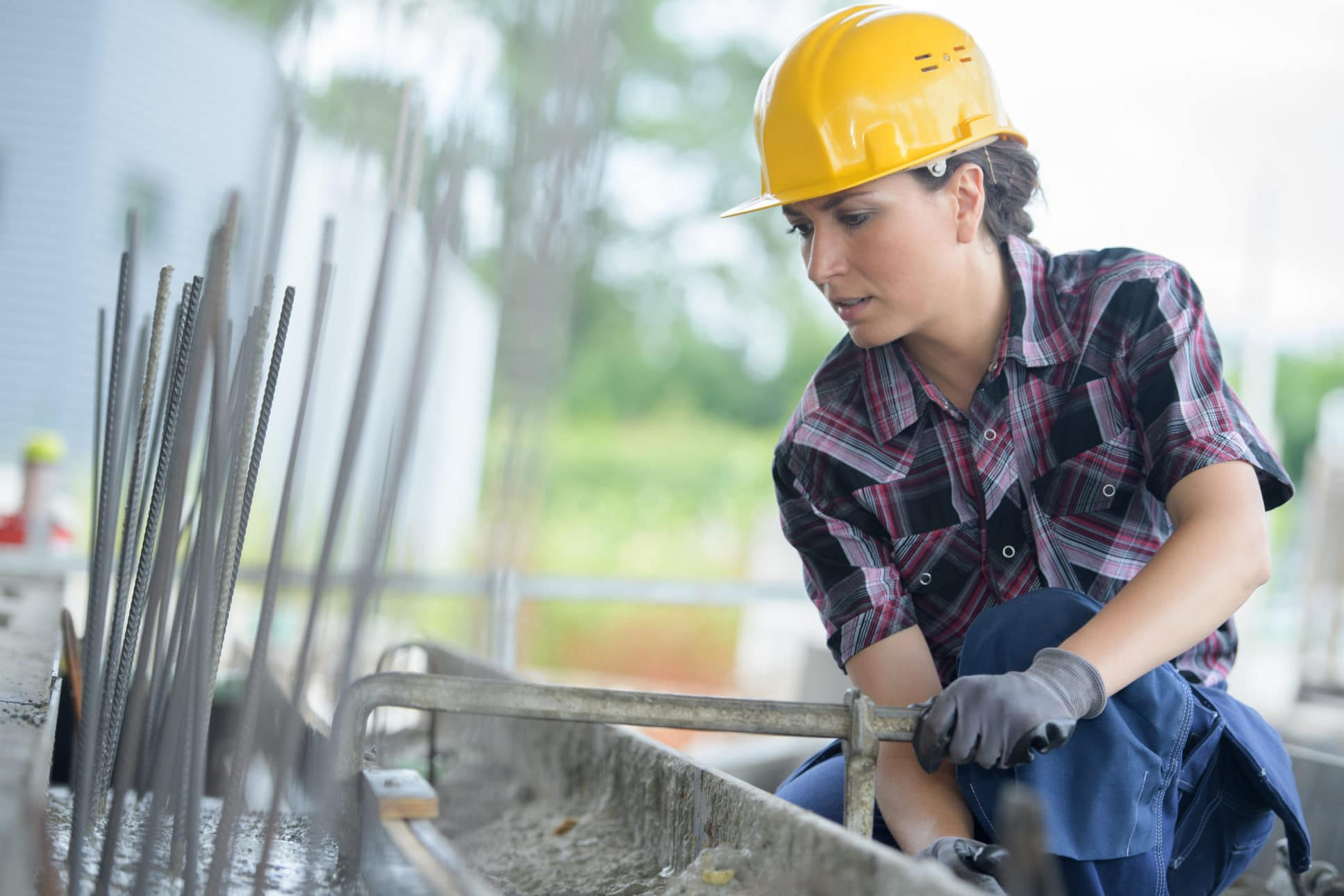 woman working on metal structure