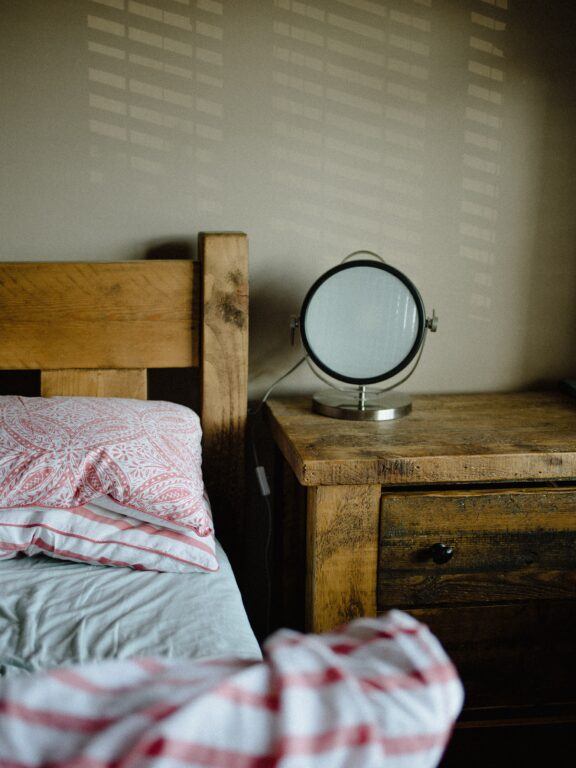Wood beam headboard with matching nightstand.