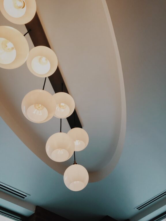 indented ceiling with wood beam light fixture.