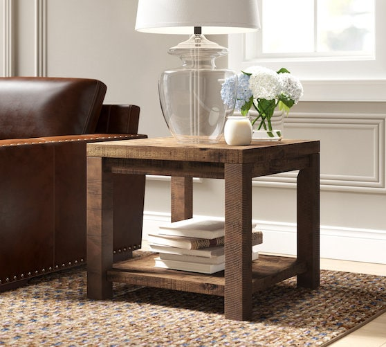 dark wood end table near end of couch
