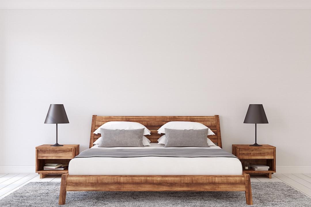 reclaimed wood bedframe in bedroom