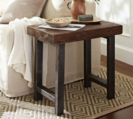 reclaimed wood end table on rug in living room