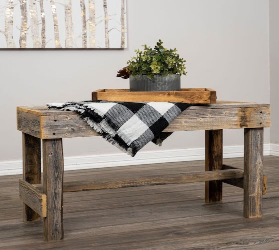 reclaimed wooden bench with blanket and plant decoration