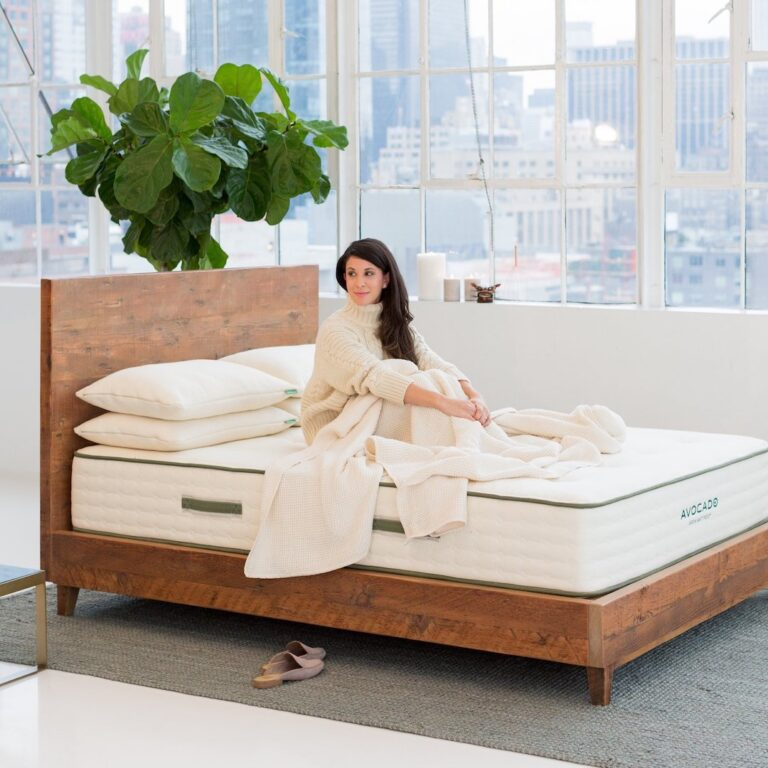 woman sitting on a reclaimed wood bed frame