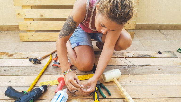 woman working on diy reclaimed wood chest