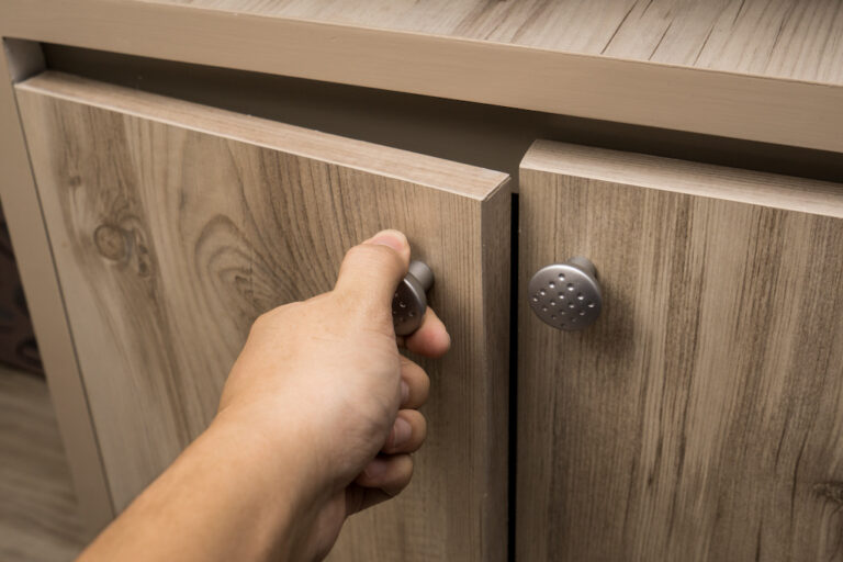 hand opening reclaimed wood cabinet