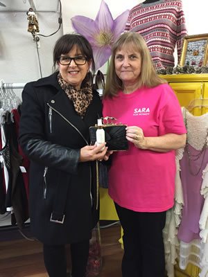 Judy at SARA for Women donating a prize