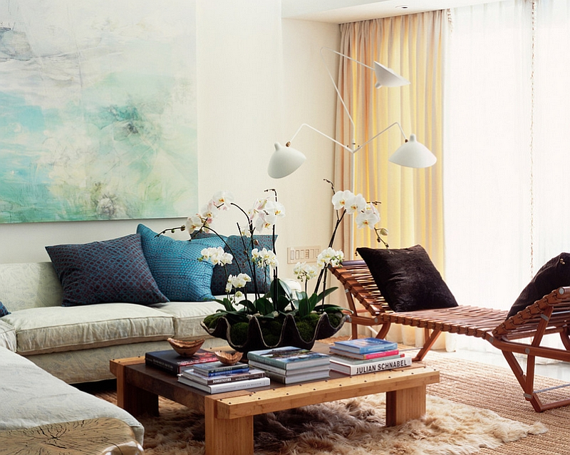 Bright-Feminine-Living-Rooms-Decorating-Ideas-Of-Delicate-Finesse-With-White-Wall-Wall-Art-CreamCurtain-Glass-Window-Wooden-Table-Grey-Sofas-Blue-and-Black-Pillows-Cream-Rug-Floor-Lamps