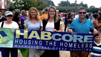 Executive team with HABcore banner