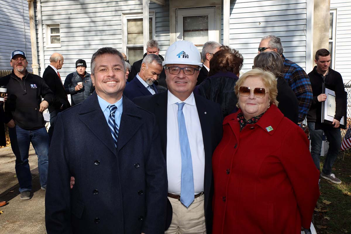 a group of supporters at the groundbreaking